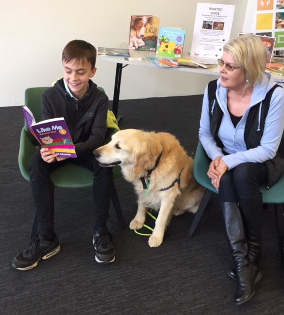 Ry & Reading Dog Oscar with 'Like me' book