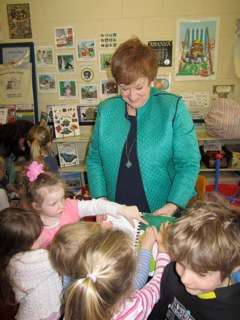 Hazel sharing 'Braille' book picture book Seaford Junior Community Library